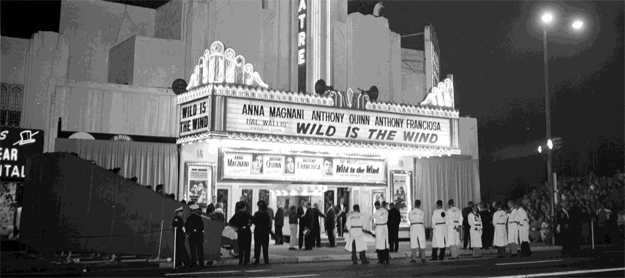 The Four Star Theatre on Wilshire Blvd  in 1957 for a movie opening included bleacher seating on the sidewalk for fans eager to see movie stars.
