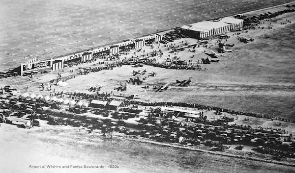 An undated 1920's aerial photo shows a large crowd - probably some kind of air show or event. Across the road work appears to be started on housing or streets yet to be built.