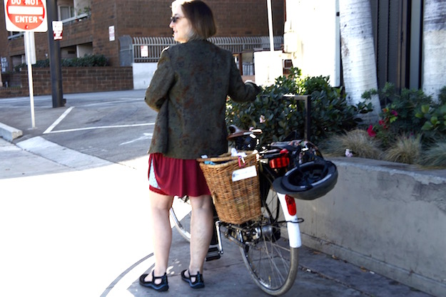 Canady's touring bike has baskets and hooks to carry work, groceries, or her product line.